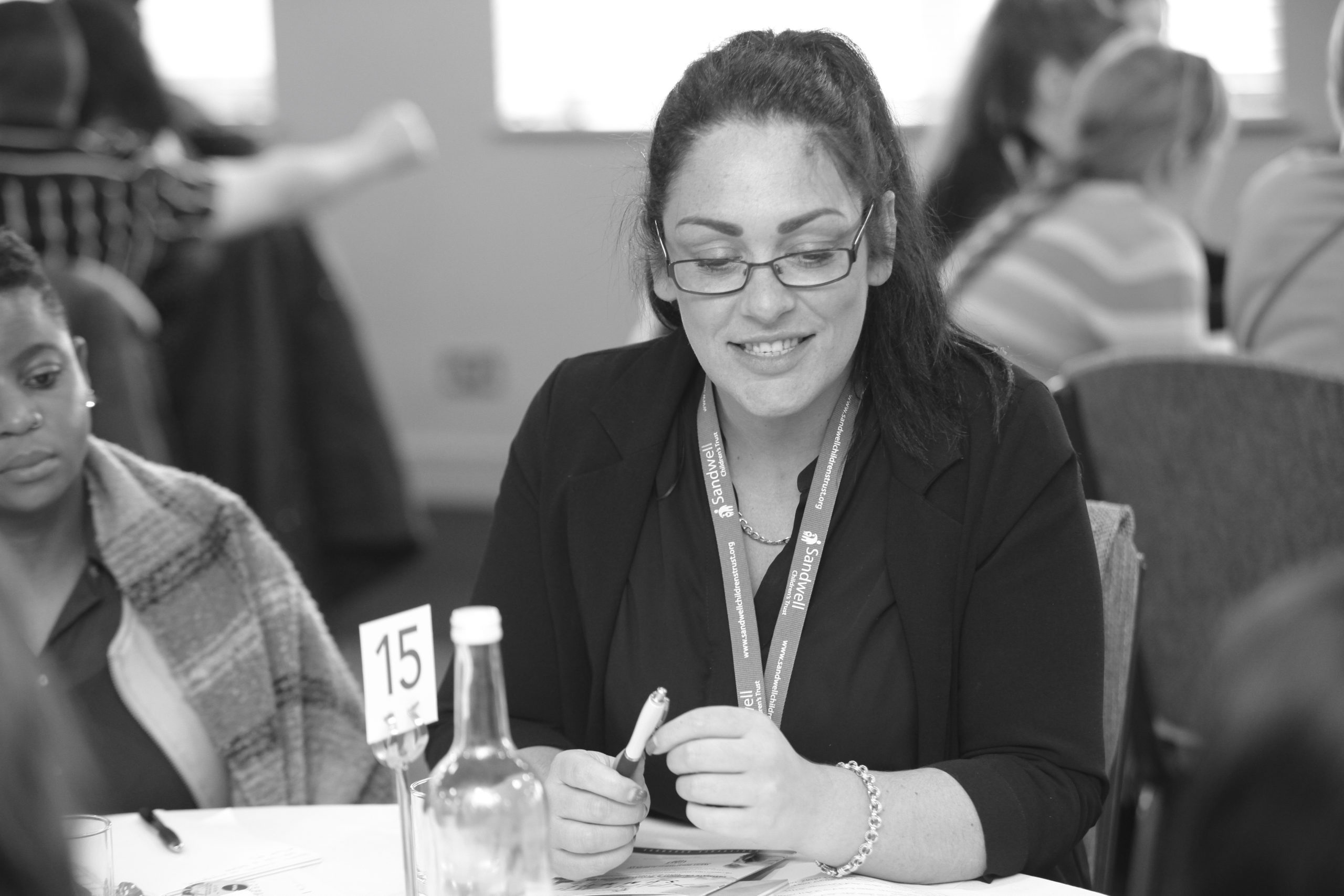 A woman smiling at a staff training event